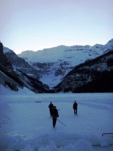 Locals playing hockey on frozen Lake Louise.