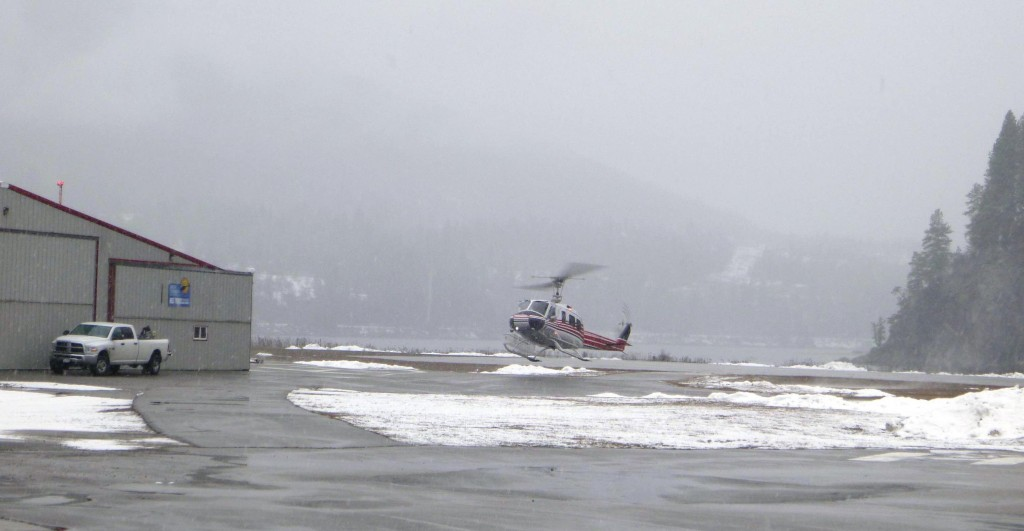 Helicopter taking off for Baldface Lodge from Nelson Airport.
