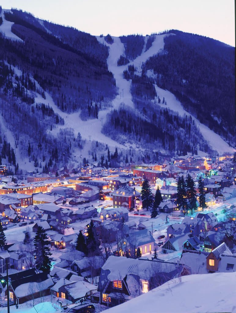 Photo Title: Night Lights in the town of Telluride and torchlight parade on the slopes of the ski area Photo By: Doug Berry