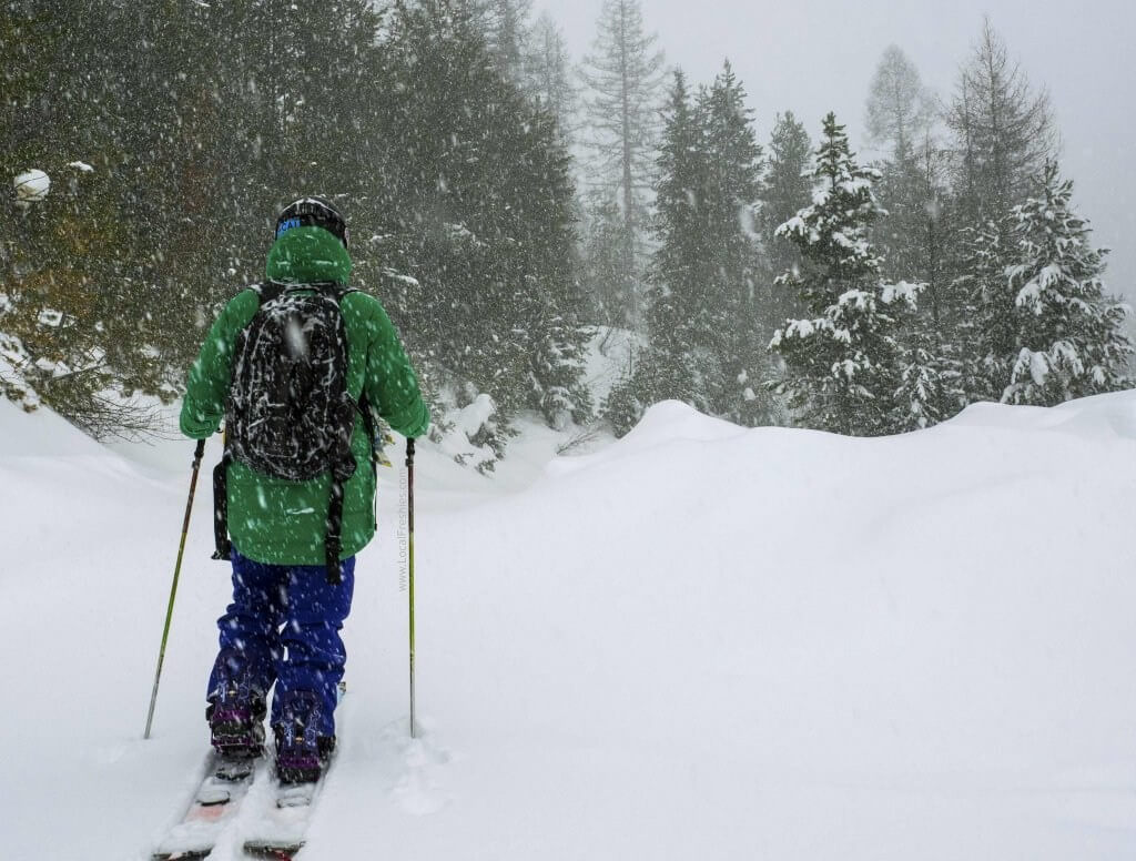 Splitboarder in lookout pass backcountry during snowstorm in idaho