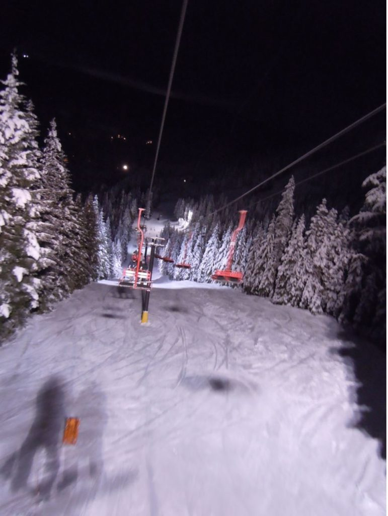 Guide to Mt Hood's Ski Resorts Riding a chairlift at night at Mt Hood Ski Bowl