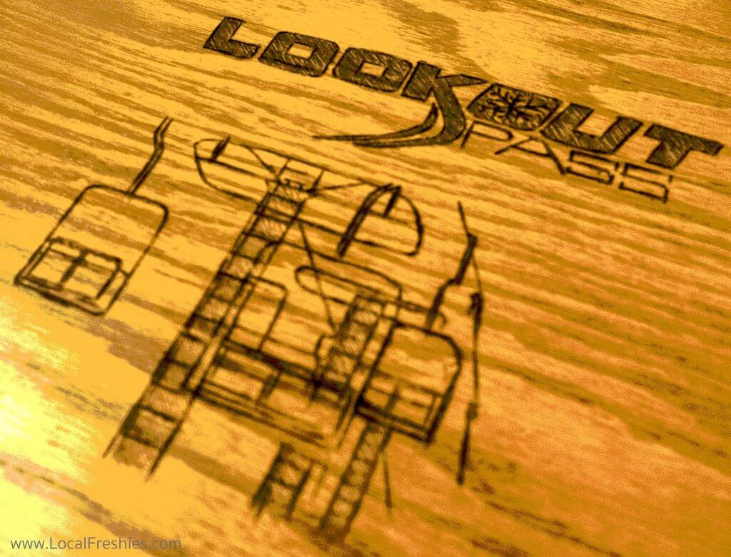 Wooden art of Lookout Pass at Wallace Brewing