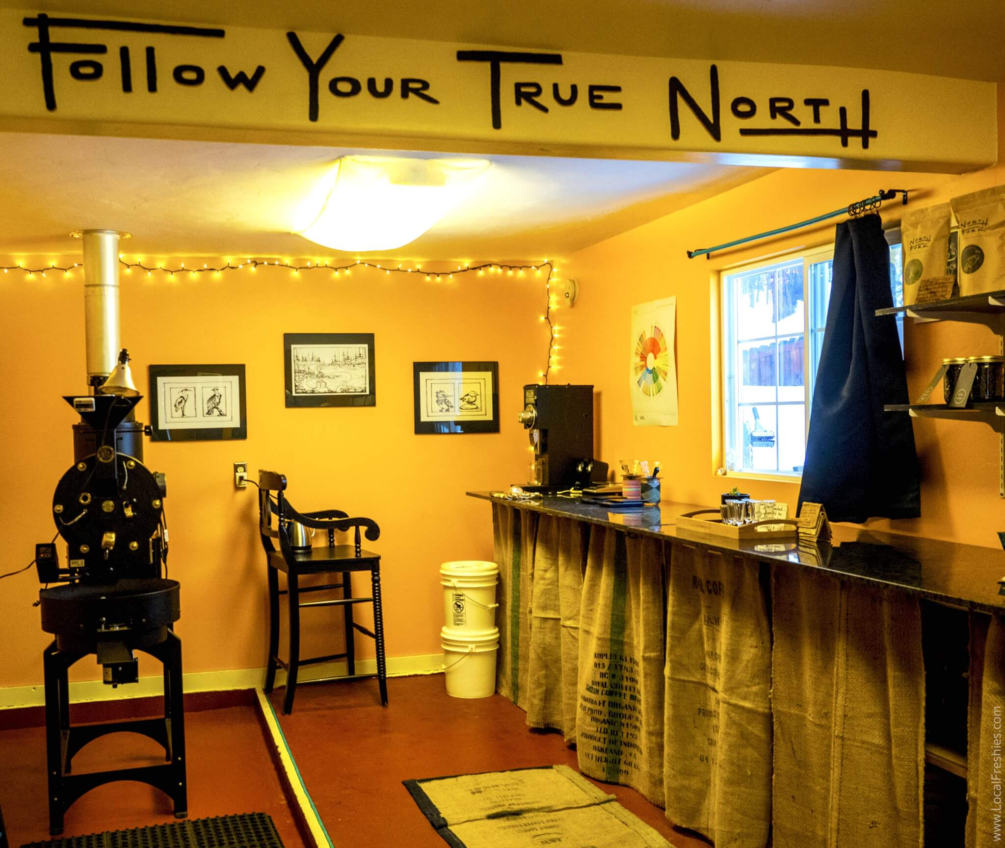 Brundage McCall North Fork Coffee Roasters Follow your true north sign interior