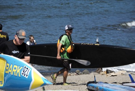 Naish Gorge Paddle Challenge 2016 SUP Standup Paddleboarding Post Race carrying surfboard Hood River Oregon PNW