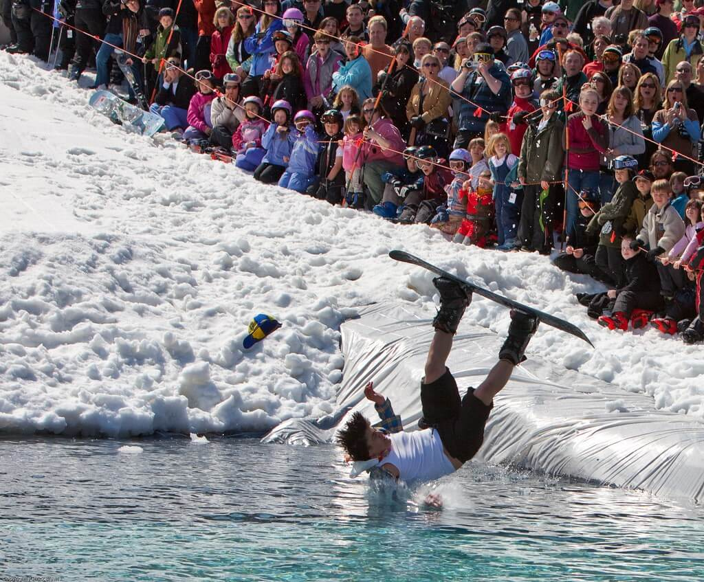 Snowboarder falling in Sugarbush Pond Skim