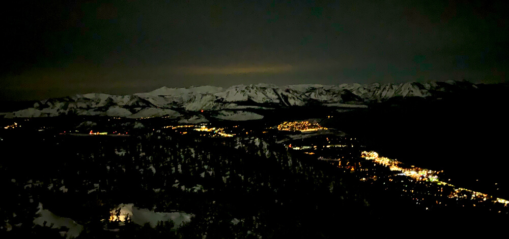 skiing under moonlight night panorama south lake tahoe