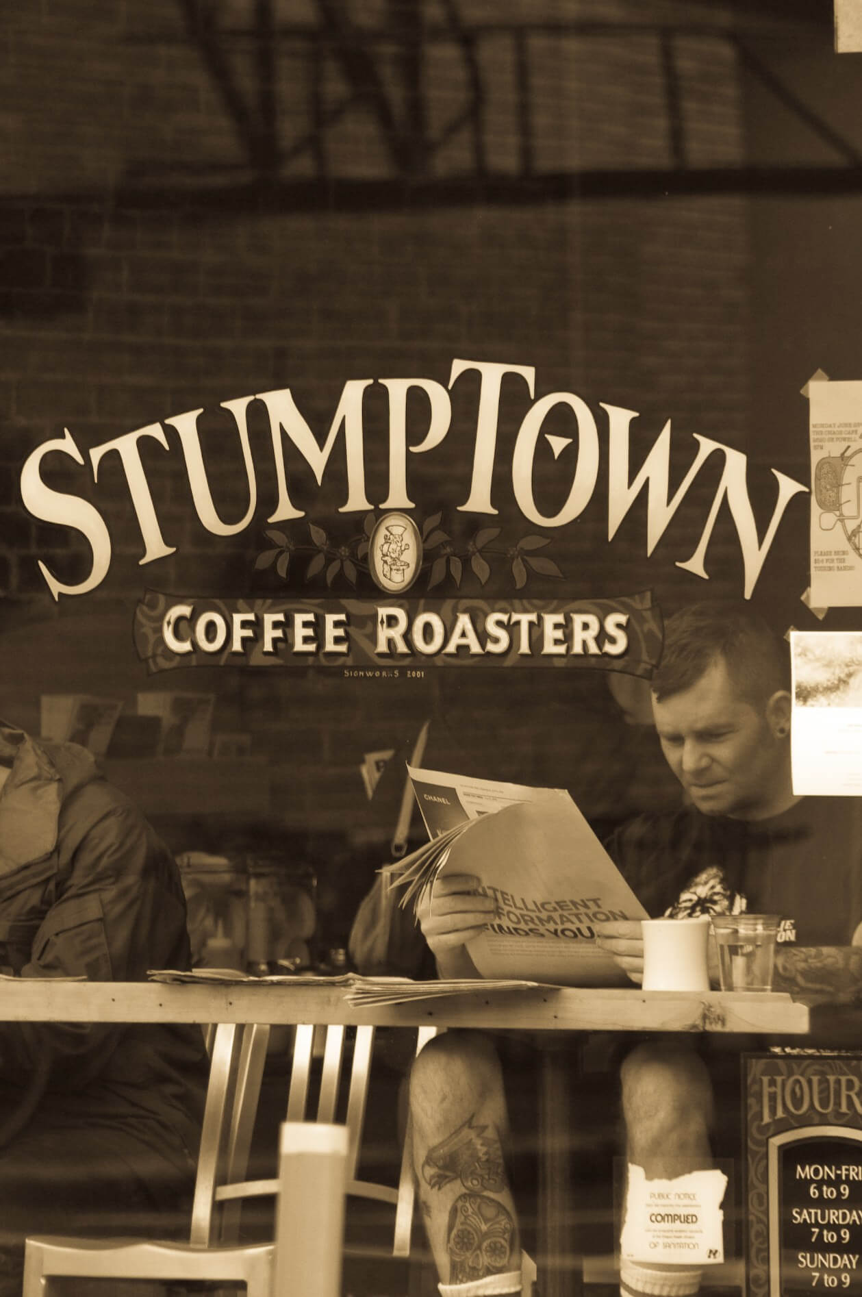 Guide to Mt Hood's Ski Resorts Person reading in front of Stumptown Coffee in Portland