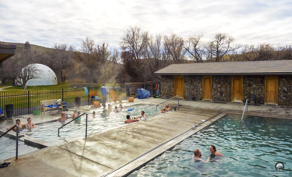 Public steaming pool on a partly cloudy winter day at the Miracle Hot Springs near Twin Falls Idaho