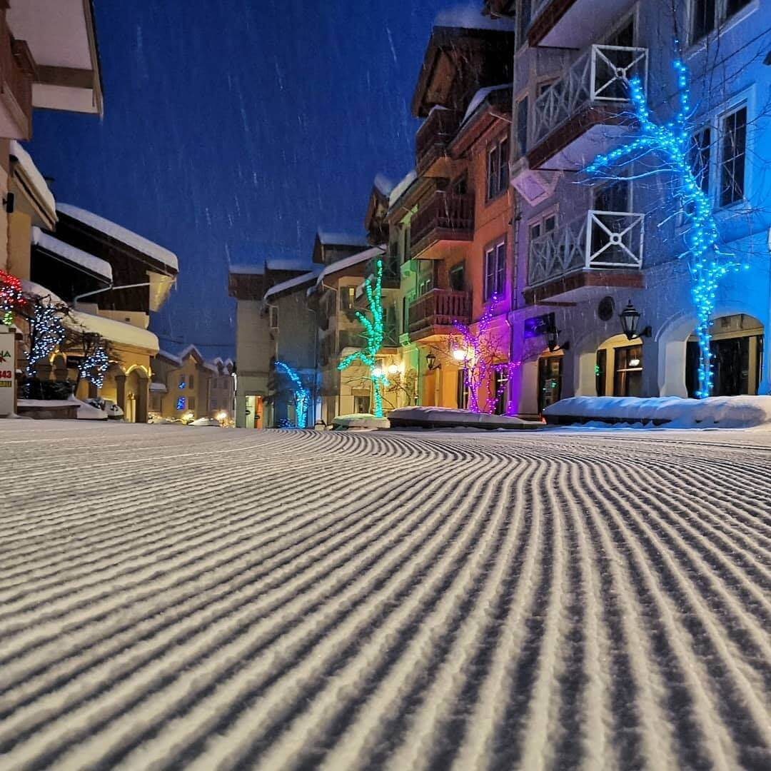 Ski-through European village at Sun Peaks Resort near Kamloops British Columbia at night with Christmas lights
