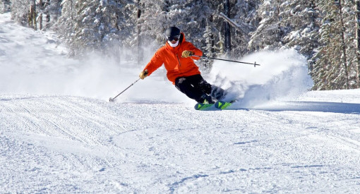 skier carving perfect soft snow at 49 North Mountain Resort