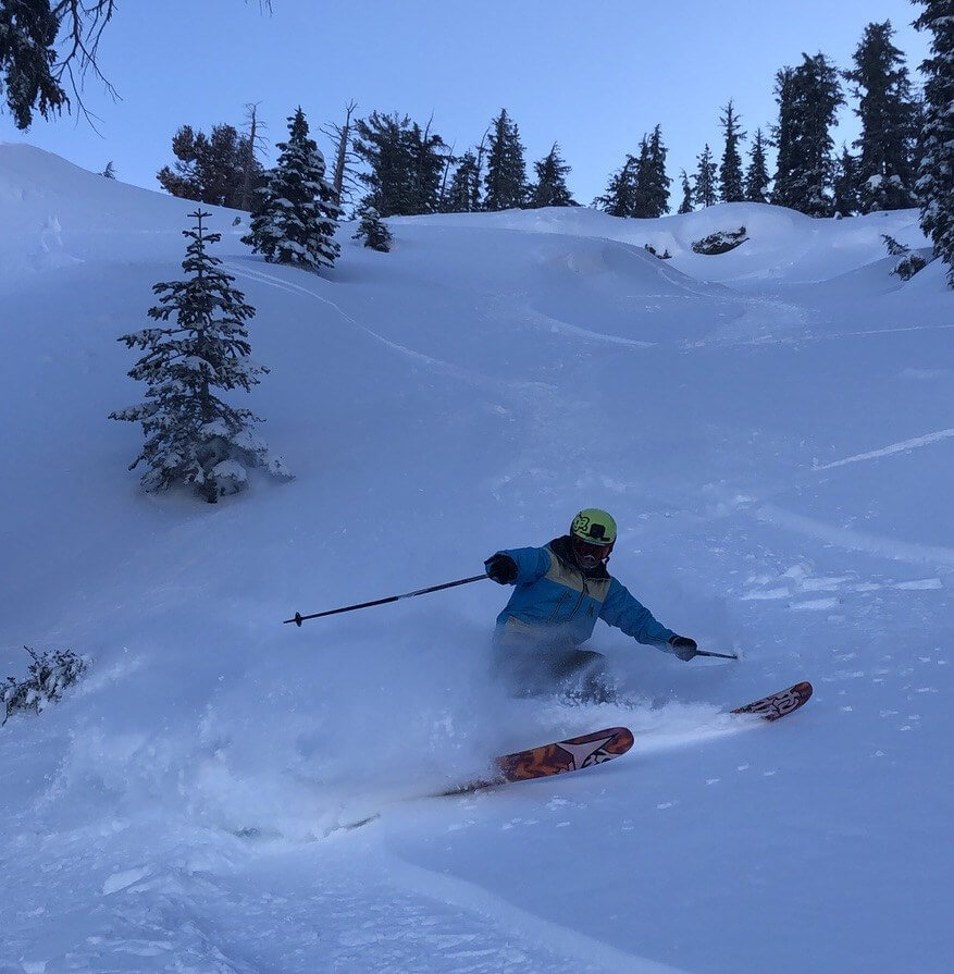 Skier skiing powder in a chute at Kirkwood Mountain Resort