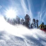 snowboarder at red river ski area new mexico on the groomers