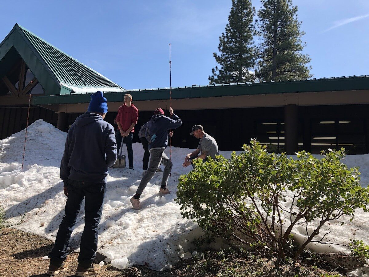 Jason Bilek avalanche instructor showing students how to find an avalanche burial