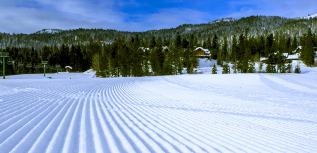 Corduroy snow on a sunny day at Tamarack Resort in Idaho