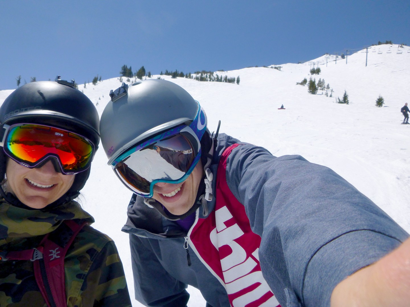 Snowboarders wearing sunny lenses in spring at Mt Bachelor