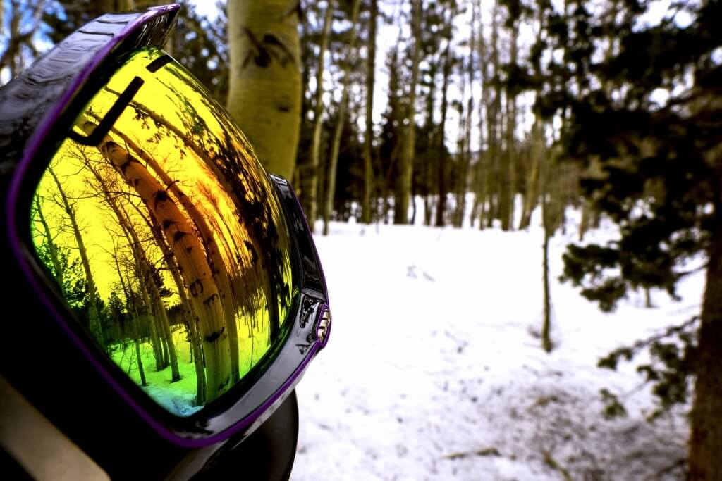 Closeup of Spy Goggles with Aspen Trees behind it
