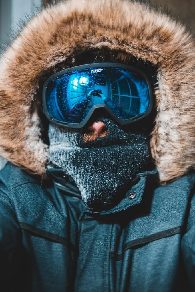 Spy Snowboard Goggles on Man in a winter coat