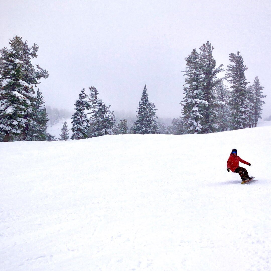 Enjoying the best womens snowboard boot at Heavenly Mountain on a snowy day