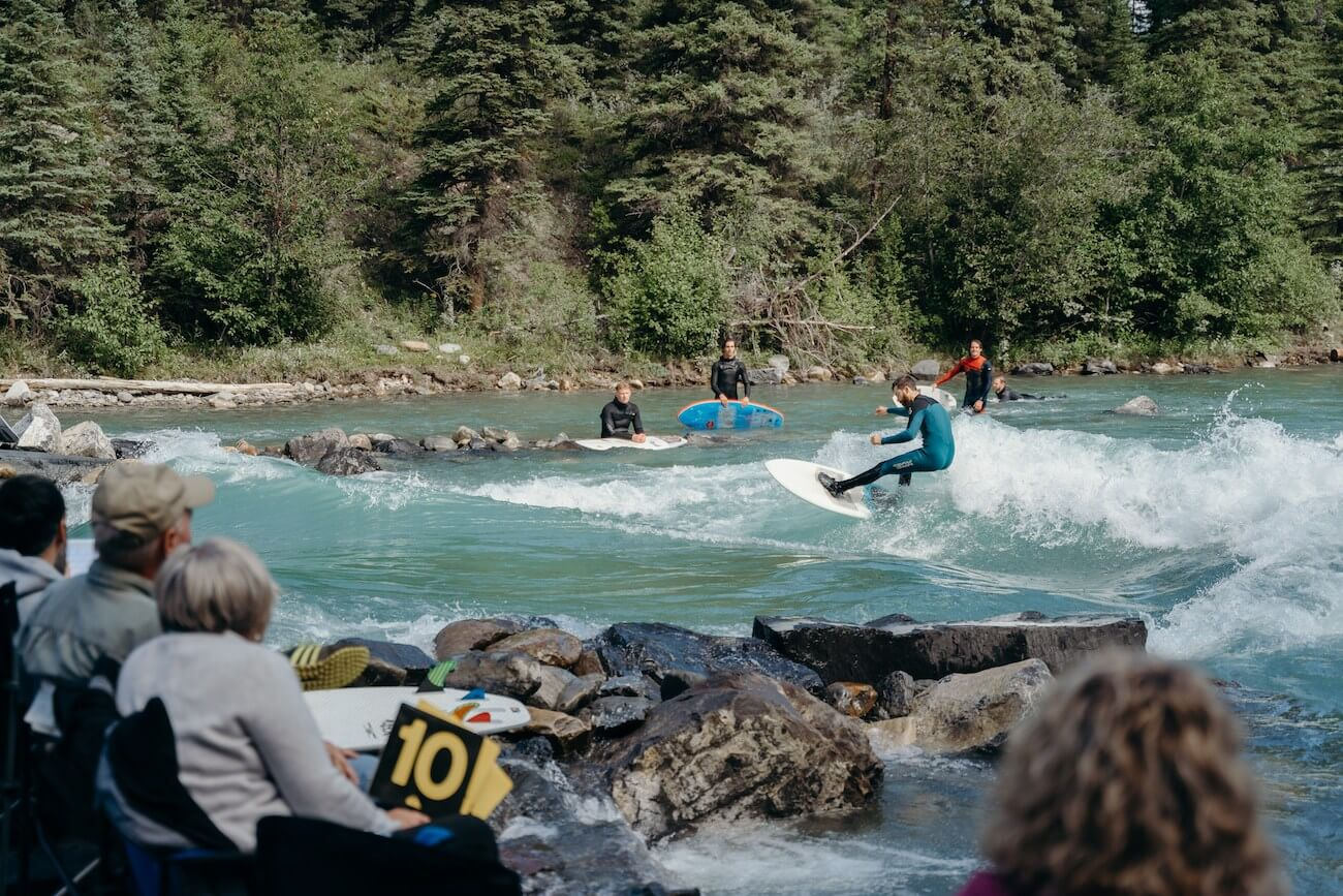 Surfer at Alberta Cup 2019 river surfing the mountain wave on the Lower Kananaskis River