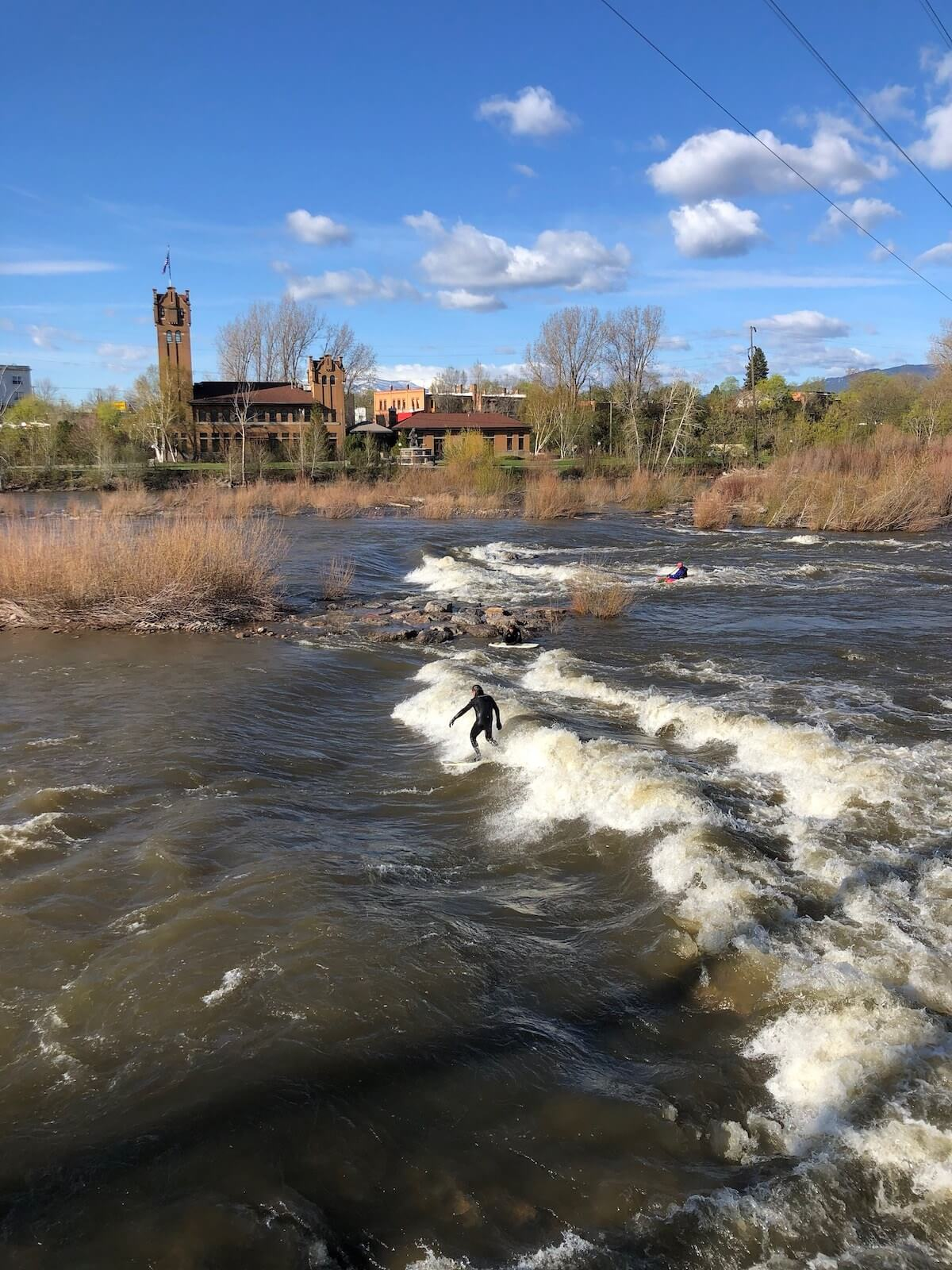 surfer river surfing on Brennan's Wave in Missoula Montana