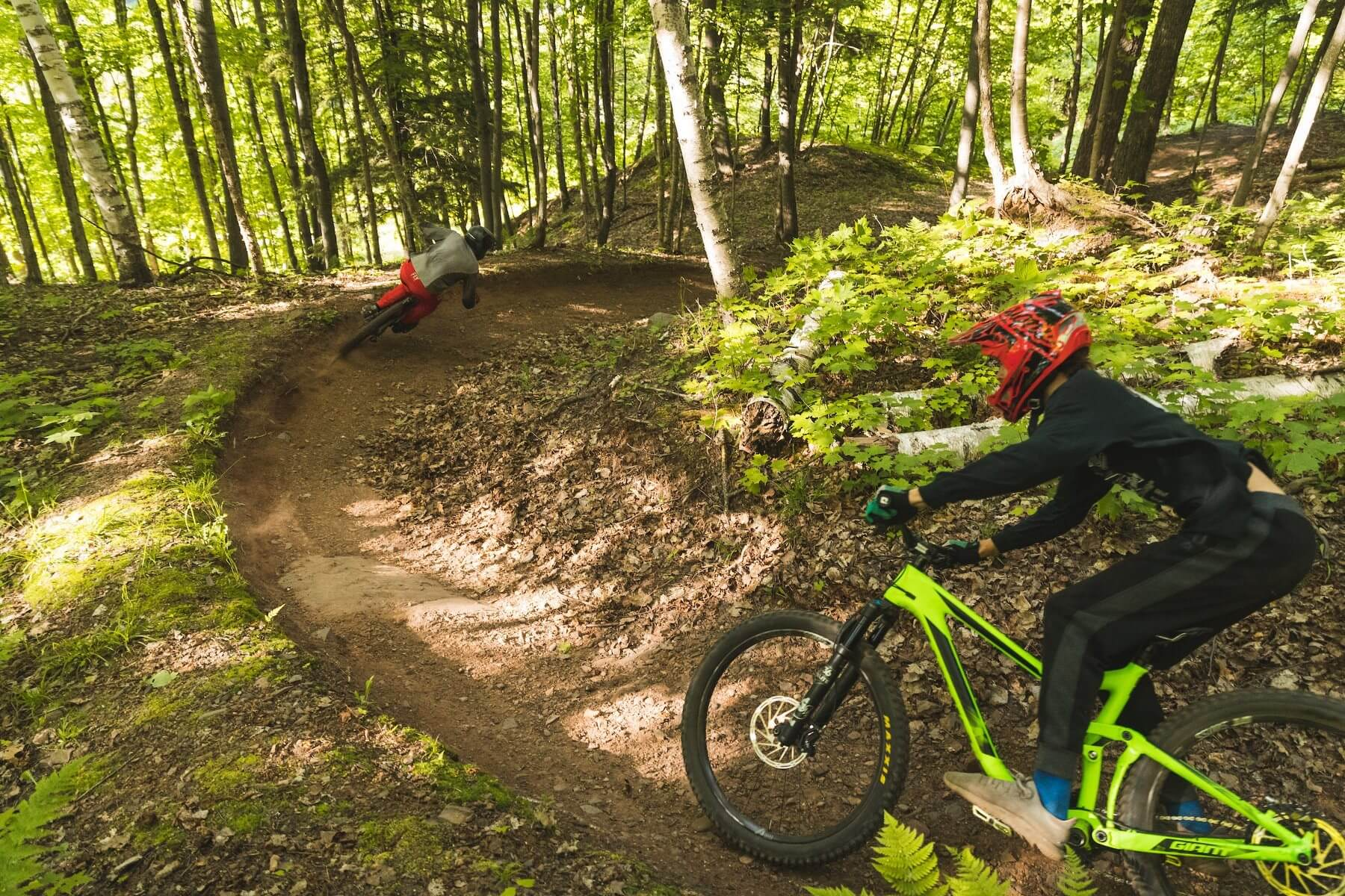 2 bikers enjoying singletrack at mountain bike park at Marquette Mountain