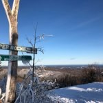 Summit of Marquette Mountain Ski Area overlooking Lake Superior in the distance