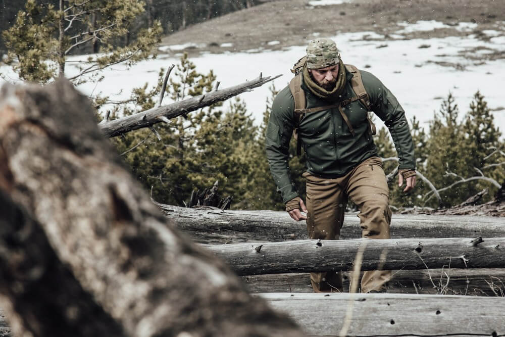 Ex-marine hiking in the wilderness wearing Beyond Clothing Outerwear made in USA jacket