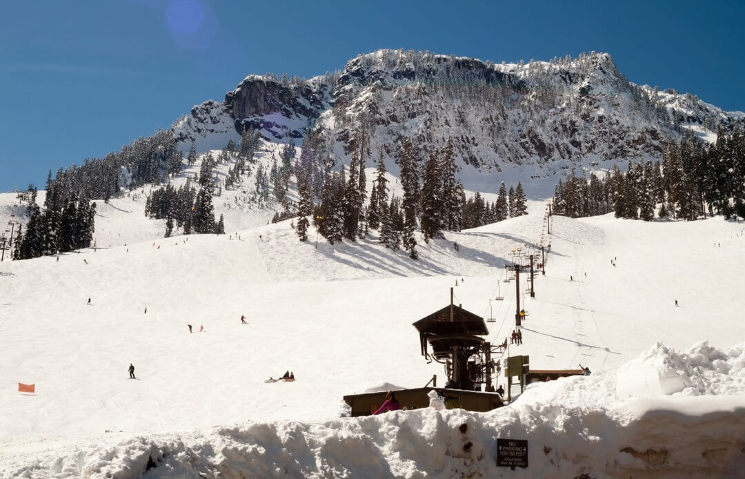 Best ski area for La Nina winter chairlift with mountain behind it