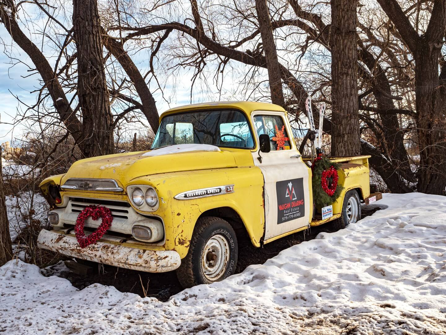 things to do in Taos NM old pickup truck near Arroyo Seco during winter