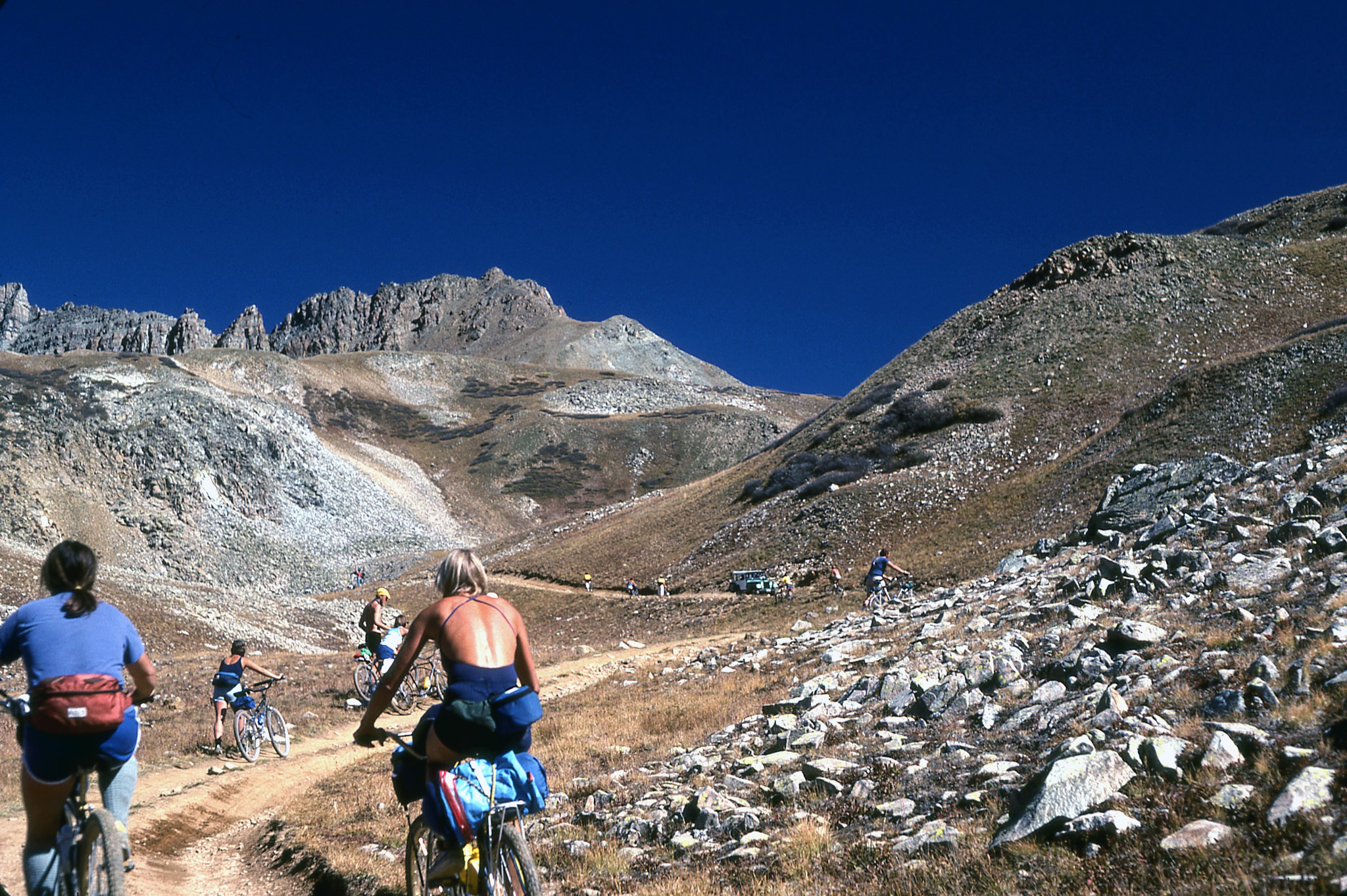 mountain bikers on sunny day on Pearl Pass near Crested Butte Colorado