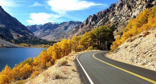 Lundy Lake Road in fall colors with the Eastern Sierra behind it