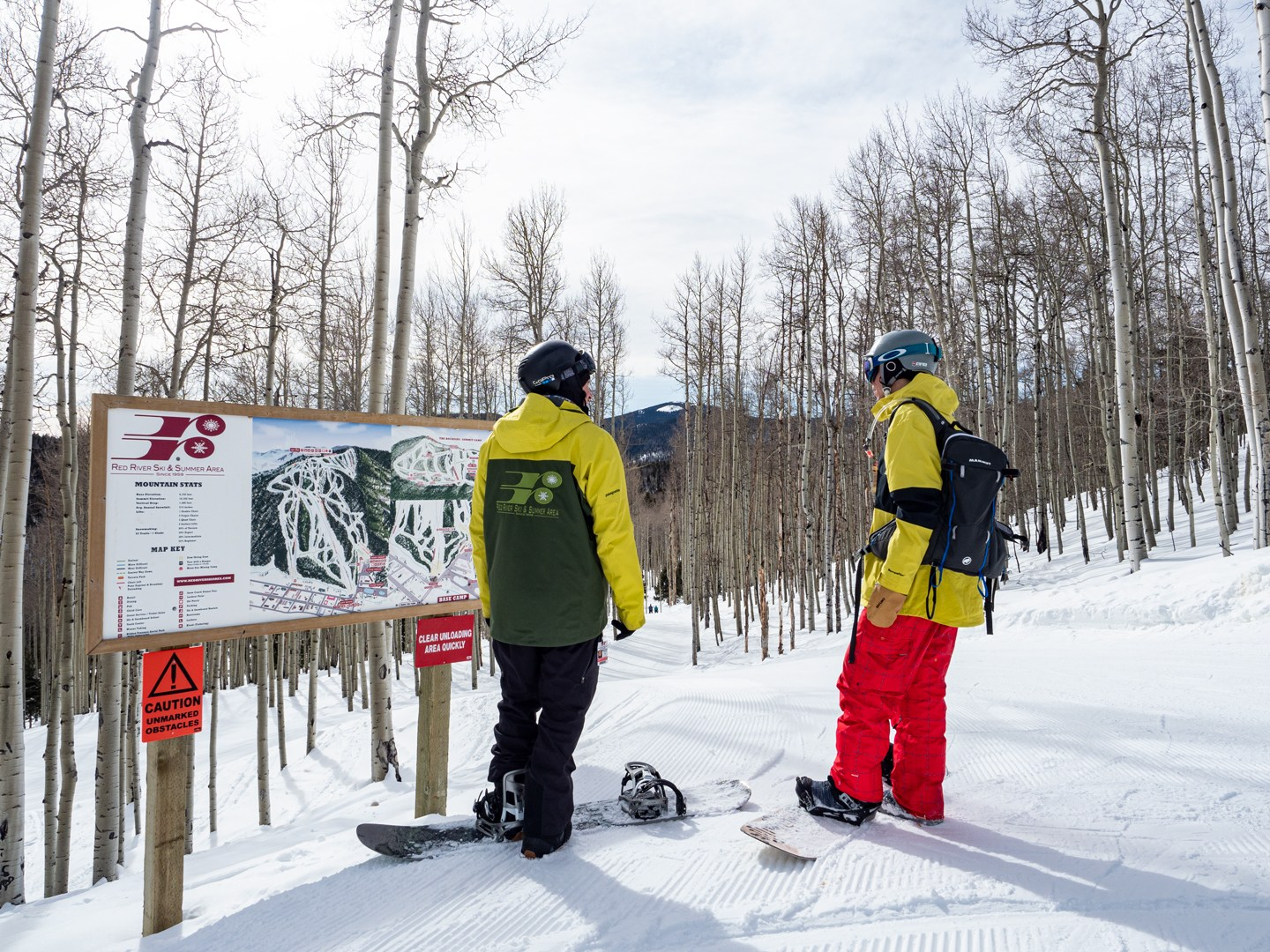 Snowboarders on the backside of Red River Ski Resort